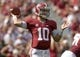 Oct 5, 2013; Tuscaloosa, AL, USA; Alabama Crimson Tide quarterback A.J. McCarron (10) rolls out to pass against the Georgia State Panthers during the second quarter at Bryant-Denny Stadium. Mandatory Credit: John David Mercer-USA TODAY Sports