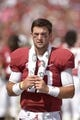 Oct 5, 2013; Tuscaloosa, AL, USA; Alabama Crimson Tide quarterback A.J. McCarron (10) walks the bench area during the fourth quarter against the Georgia State Panthers at Bryant-Denny Stadium. Alabama defeated Georgia State 45-3. Mandatory Credit: John David Mercer-USA TODAY Sports