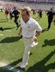 Oct 5, 2013; Tuscaloosa, AL, USA; Alabama Crimson Tide head coach Nick Saban runs off the field field after defeating the Georgia State Panthers 45-3 at Bryant-Denny Stadium. Mandatory Credit: John David Mercer-USA TODAY Sports