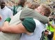Oct 5, 2013; Iowa City, IA, USA;  Michigan State Spartans quarterback Connor Cook (18) gets a hug from his mom following the teams win against the Iowa Hawkeyes at Kinnick Stadium. Michigan State beat Iowa 26-14.  Mandatory Credit: Reese Strickland-USA TODAY Sports