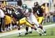 Oct 5, 2013; Iowa City, IA, USA;  Iowa Hawkeyes running back Damon Bullock (5) is tackled by Michigan State Spartans linebacker Anthony Hitchens (31) at Kinnick Stadium. Michigan State beat Iowa 26-14.  Mandatory Credit: Reese Strickland-USA TODAY Sports