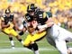 Oct 5, 2013; Iowa City, IA, USA;  Iowa Hawkeyes quarterback Jake Rudock (15) is sacked by Michigan State Spartans linebacker Marcus Rush (44) at Kinnick Stadium. Michigan State beat Iowa 26-14.  Mandatory Credit: Reese Strickland-USA TODAY Sports