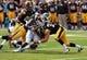 Oct 5, 2013; Iowa City, IA, USA;  Iowa Hawkeyes linebacker John Lowdermilk (37) tackles  Michigan State Spartans player Delton Williams (22) at Kinnick Stadium. Michigan State beat Iowa 26-14.  Mandatory Credit: Reese Strickland-USA TODAY Sports