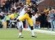Oct 5, 2013; Iowa City, IA, USA;  Iowa Hawkeyes receiver  Damond Powell (22) is defended by the Michigan State Spartans cornerback Trae Waynes (15) at Kinnick Stadium. Michigan State beat Iowa 26-14.  Mandatory Credit: Reese Strickland-USA TODAY Sports