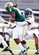 Oct 5, 2013; Birmingham, AL, USA;  Florida Atlantic Owls linebacker Adarius Glanton (4) tackles UAB Blazers running back Darrin Reaves (5) from behind at Legion Field. Mandatory Credit: Marvin Gentry-USA TODAY Sports