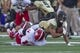 Oct 5, 2013; Winston-Salem, NC, USA; Wake Forest Demon Deacons wide receiver Michael Campanaro (3) gets tackled by North Carolina State Wolfpack safety Jarvis Byrd (14) during the second quarter at BB&T Field. Mandatory Credit: Jeremy Brevard-USA TODAY Sports