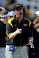 Oct 5, 2013; Hattiesburg, MS, USA; Southern Miss Golden Eagles head coach Todd Monken talks to an official during the second quarter of their game against the FIU Golden Panthers at M.M. Roberts Stadium. Mandatory Credit: Chuck Cook-USA TODAY Sports