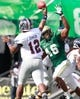 Oct 5, 2013; Birmingham, AL, USA; Florida Atlantic Owls quarterback Jaquez Johnson  (12) passes the ball as UAB Blazers defensive end Diaheem Watkins (46) puts the pressure on him  at Legion Field. Mandatory Credit: Marvin Gentry-USA TODAY Sports