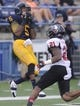 Oct 5, 2013; Kent, OH, USA; Kent State Golden Flashes wide receiver Tyshon Goode (5) catches a touchdown past the defense of Northern Illinois Huskies cornerback Marlon Moore (21) during the third quarter at Dix Stadium. Mandatory Credit: Ken Blaze-USA TODAY Sports