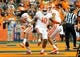 Oct 5, 2013; Syracuse, NY, USA; Clemson Tigers quarterback Tajh Boyd (10) celebrates a touchdown by running back Zac Brooks (left) during the second quarter against the Syracuse Orangeat the Carrier Dome.  Clemson defeated Syracuse 49-14.  Mandatory Credit: Rich Barnes-USA TODAY Sports