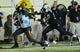 Oct 5, 2013; Nashville, TN, USA; Missouri Tigers running back Marcus Murphy (6) stiff arms Vanderbilt Commodores safety Javon Marshall (31) during the first half at Vanderbilt Stadium. Mandatory Credit: Don McPeak-USA TODAY Sports