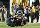 Oct 5, 2013; Nashville, TN, USA; Vanderbilt Commodores quarterback Austyn Carter-Samuels (6) is tackled by Missouri Tigers linebacker Donovan Bonner (8) during the first half at Vanderbilt Stadium. Mandatory Credit: Don McPeak-USA TODAY Sports