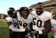 Oct 5, 2013; Hattiesburg, MS, USA; Fiu Golden Panthers linebacker Markeith Russell (22), defensive tackle Isame Faciane (99) and offensive tackle David Delsoin (50) celebrate at the end of their game against the Southern Miss Golden Eagles at M.M. Roberts Stadium. FIU won 24-23. Mandatory Credit: Chuck Cook-USA TODAY Sports
