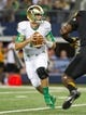 Oct 5, 2013; Arlington, TX, USA; Notre Dame Fighting Irish quarterback Tommy Rees (11) drops back in the first quarter against the Arizona State Sun Devils at AT&T Stadium. Mandatory Credit: Matt Cashore-USA TODAY Sports