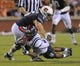 Oct 5, 2013; Auburn, AL, USA; Mississippi Rebels running back I'Tavius Mathers (5) is brought down by Auburn Tigers defense at Jordan Hare Stadium. Mandatory Credit: Shanna Lockwood-USA TODAY Sports