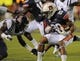 Oct 5, 2013; Auburn, AL, USA; Auburn Tigers running back Corey Grant (20) tries to evade the defense of Mississippi Rebels at Jordan Hare Stadium. Mandatory Credit: Shanna Lockwood-USA TODAY Sports