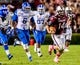 Oct 5, 2013; Columbia, SC, USA; South Carolina Gamecocks quarterback Connor Shaw (14) scrambles for a big gain against the Kentucky Wildcats in the third quarter at Williams-Brice Stadium. Mandatory Credit: Jeff Blake-USA TODAY Sports