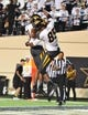 Oct 5, 2013; Nashville, TN, USA; Missouri Tigers wide receiver Marcus Lucas (85) celebrates with Tigers wide receiver Bud Sasser (21) after making a touchdown catch against the Vanderbilt Commodores during the second half at Vanderbilt Stadium. The Tigers beat the Commodores 51-28. Mandatory Credit: Don McPeak-USA TODAY Sports