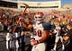 Oct 5, 2013; El Paso, TX, USA; UTEP Miners linebacker Michael Kelley (50) carries the Miner Pickaxe onto the field before facing the Louisiana Tech Bulldogs at Sun Bowl Stadium. Mandatory Credit: Ivan Pierre Aguirre-USA TODAY Sports