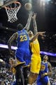 October 5, 2013; Ontario, CA, USA; Los Angeles Lakers center Robert Sacre (50) goes in for a basket against the defense of Golden State Warriors small forward Draymond Green (23) during the second half at Citizens Business Bank Arena. Mandatory Credit: Gary A. Vasquez-USA TODAY Sports