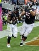 Oct 6, 2013; Chicago, IL, USA Chicago Bears running back Matt Forte (22)celebrates his 2-point conversion with offensive guard Kyle Long (75) during the second half against New Orleans at Soldier Field. Mandatory Credit: Matt Marton-USA TODAY Sports