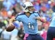 Oct 6, 2013; Nashville, TN, USA; Tennessee Titans quarterback Ryan Fitzpatrick (4) passes against the Kansas City Chiefs during the first half at LP Field. The Chiefs beat the Titans 26-17. Mandatory Credit: Don McPeak-USA TODAY Sports