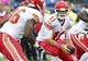 Oct 6, 2013; Nashville, TN, USA; Kansas City Chiefs quarterback Alex Smith (11) takes the snap and drops back into the pocket against the Tennessee Titans during the first half at LP Field. The Chiefs beat the Titans 26-17. Mandatory Credit: Don McPeak-USA TODAY Sports