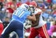 Oct 6, 2013; Nashville, TN, USA; Tennessee Titans defensive end Karl Klug (97) grapples with Kansas City Chiefs guard Jeff Allen (71) during the first half at LP Field. The Chiefs beat the Titans 26-17. Mandatory Credit: Don McPeak-USA TODAY Sports