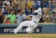 Oct 6, 2013; Los Angeles, CA, USA; Los Angeles Dodgers shortstop Hanley Ramirez (13) slides into third after hitting a triple in the fourth inning against the Atlanta Braves in game three of the National League divisional series playoff baseball game at Dodger Stadium. Mandatory Credit: Jayne Kamin-Oncea-USA TODAY Sports