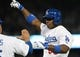 Oct 6, 2013; Los Angeles, CA, USA; Los Angeles Dodgers right fielder Yasiel Puig (66) celebrates after hitting an RBI single in the fourth inning against the Atlanta Braves in game three of the National League divisional series playoff baseball game at Dodger Stadium. Mandatory Credit: Jayne Kamin-Oncea-USA TODAY Sports