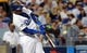 Oct 6, 2013; Los Angeles, CA, USA; Los Angeles Dodgers shortstop Hanley Ramirez (13) hits a triple in the fourth inning against the Atlanta Braves in game three of the National League divisional series playoff baseball game at Dodger Stadium. Mandatory Credit: Jayne Kamin-Oncea-USA TODAY Sports