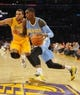 Oct 6, 2013; Los Angeles, CA, USA; Denver Nuggets forward Quincy Miller (30) dribbles along the baseline against Los Angeles Lakers forward Elias Harris (2) during the second half at Staples Center. The Nuggets won 97-88. Mandatory Credit: Christopher Hanewinckel-USA TODAY Sports
