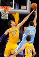 Oct 6, 2013; Los Angeles, CA, USA; Los Angeles Lakers forward Pau Gasol (16) attempts to block a shot by Denver Nuggets center JaVale McGee (34) during the first half at Staples Center. Mandatory Credit: Christopher Hanewinckel-USA TODAY Sports