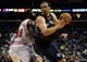 Oct 7, 2013; St. Louis, MO, USA; Memphis Grizzlies center Kosta Koufos (41) drives to the basket as Chicago Bulls center Nazr Mohammed (48) defends during the third quarter at Scottrade Center. Chicago defeated Memphis 106-87. Mandatory Credit: Jeff Curry-USA TODAY Sports