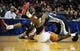 Oct 7, 2013; St. Louis, MO, USA; Memphis Grizzlies shooting guard Jamaal Franklin (22) battles for a loose ball with Chicago Bulls center Nazr Mohammed (48) during the third quarter at Scottrade Center. Chicago defeated Memphis 106-87. Mandatory Credit: Jeff Curry-USA TODAY Sports