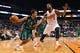 Oct 7, 2013; Phoenix, AZ, USA; Haifa  guard Moran Roth (9) drives the ball against Phoenix Suns forward Markieff Morris (11) in the first half at US Airways Center. Mandatory Credit: Jennifer Stewart-USA TODAY Sports