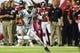 Oct 7, 2013; Atlanta, GA, USA; New York Jets quarterback Geno Smith (7) runs the ball in the second half against the Atlanta Falcons at the Georgia Dome. The Jets won 30-28. Mandatory Credit: Daniel Shirey-USA TODAY Sports