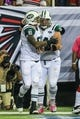 Oct 7, 2013; Atlanta, GA, USA; New York Jets tight end Kellen Winslow (81) celebrates a touchdown with center Nick Mangold (74) in the second half against the Atlanta Falcons at the Georgia Dome. The Jets won 30-28. Mandatory Credit: Daniel Shirey-USA TODAY Sports
