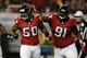 Oct 7, 2013; Atlanta, GA, USA; Atlanta Falcons defensive end Osi Umenyiora (50) reacts with defensive tackle Corey Peters (91) after a sack against the New York Jets during the second half at the Georgia Dome. The Jets defeated the Falcons 30-28. Mandatory Credit: Dale Zanine-USA TODAY Sports