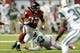 Oct 7, 2013; Atlanta, GA, USA; Atlanta Falcons running back Jacquizz Rodgers (32) breaks a tackle against the New York Jets during the second half at the Georgia Dome. The Jets defeated the Falcons 30-28. Mandatory Credit: Dale Zanine-USA TODAY Sports