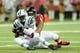 Oct 7, 2013; Atlanta, GA, USA; Atlanta Falcons defensive tackle Corey Peters (91) sacks New York Jets quarterback Geno Smith (7) during the second half at the Georgia Dome. The Jets defeated the Falcons 30-28. Mandatory Credit: Dale Zanine-USA TODAY Sports