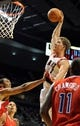 Oct 7, 2013; Portland, OR, USA; Portland Trail Blazers center Meyers Leonard (11) dunks the ball on Los Angeles Clippers center Ryan Hollins (15) during the third quarter of the game at Moda Center. Mandatory Credit: Steve Dykes-USA TODAY Sports