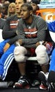 Oct 7, 2013; Portland, OR, USA; Los Angeles Clippers point guard Chris Paul (3) watches the action from the bench with ice on both his knees during the fourth quarter of the game against the Portland Trail Blazers at Moda Center. Mandatory Credit: Steve Dykes-USA TODAY Sports