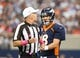 Oct 6, 2013; Arlington, TX, USA; Denver Broncos quarterback Peyton Manning (18) talks with referee Terry McAulay during the game against the Dallas Cowboys at AT&T Stadium. Mandatory Credit: Matthew Emmons-USA TODAY Sports