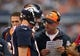 Oct 6, 2013; Arlington, TX, USA; Denver Broncos quarterback Peyton Manning (18) talks with offensive coordinator Adam Gase during a timeout from the game against the Dallas Cowboys at AT&T Stadium. Mandatory Credit: Matthew Emmons-USA TODAY Sports