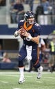 Oct 6, 2013; Arlington, TX, USA; Denver Broncos quarterback Peyton Manning (18) rolls out of the pocket in the second quarter against the Dallas Cowboys at AT&T Stadium. Mandatory Credit: Matthew Emmons-USA TODAY Sports