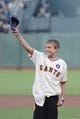 August 19, 2013; San Francisco, CA, USA; Boston Marathon survivor Aaron Hern waves to the crowd before throwing out the ceremonial first pitch before the game between the San Francisco Giants and the Boston Red Sox at AT&T Park. Mandatory Credit: Kyle Terada-USA TODAY Sports