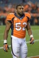 Sep 23, 2013; Denver, CO, USA; Denver Broncos linebacker Wesley Woodyard (52) reacts during the game against the Oakland Raiders at Sports Authority Field at Mile High. The Broncos defeated the Raiders 37-21.  Mandatory Credit: Kirby Lee-USA TODAY Sports