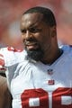 Sep 29, 2013; Kansas City, MO, USA; New York Giants defensive tackle Cullen Jenkins (99) watches play during the second half of the game against the Kansas City Chiefs at Arrowhead Stadium. The Chiefs won 31-7. Mandatory Credit: Denny Medley-USA TODAY Sports