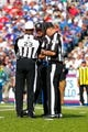 Sep 29, 2013; Orchard Park, NY, USA; NFL referee Jerome Boger (23), umpire Tony Michalek (115) and line judge Tom Stephan (68) during a game between the Buffalo Bills and the Baltimore Ravens at Ralph Wilson Stadium. Bills beat Ravens 23 to 20.  Mandatory Credit: Timothy T. Ludwig-USA TODAY Sports